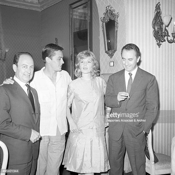 French director and singer Alain Delon posing with Italian actress Monica Vitti and Italian director and scriptwriter Michelangelo Antonioni July 1961