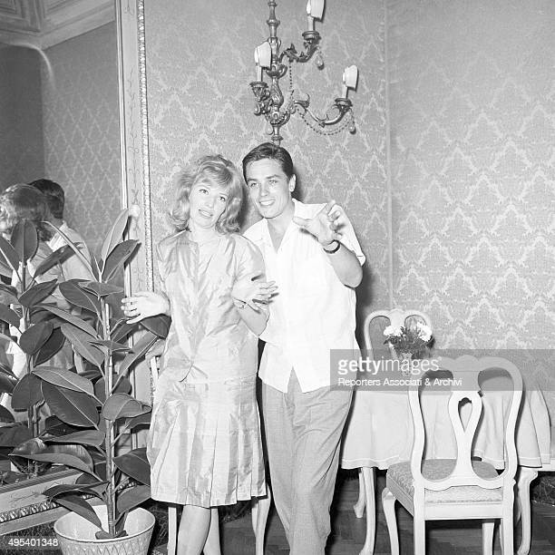 French director and singer Alain Delon posing with Italian actress Monica Vitti July 1961