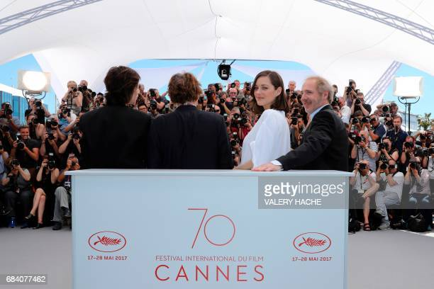 TOPSHOT French director Arnaud Desplechin and French actress Marion Cotillard pose on May 17 2017 with French actor Mathieu Amalric and French...