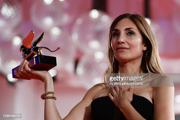 """French director Audrey Diwan poses with the Golden Lion for Best Film she received for """"L'Evenement"""" during the Winners' Photocall following the..."""