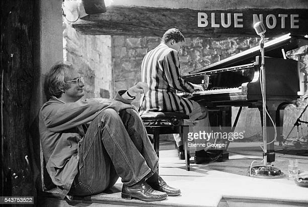 "French director Bertrand Tavernier listening to American jazz pianist and composer Herbie Hancock on the set of ""Round Midnight"" , based on the David..."
