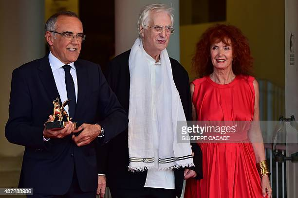 French director Bertrand Tavernier poses with French actress Sabine Azema and Venezia International Film Festival director Alberto Barbera after he...