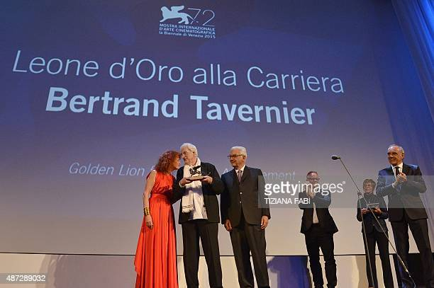 French director Bertrand Tavernier poses with French actress Sabine Azema, Venice Biennale president Paolo Baratta as Venezia International Film...