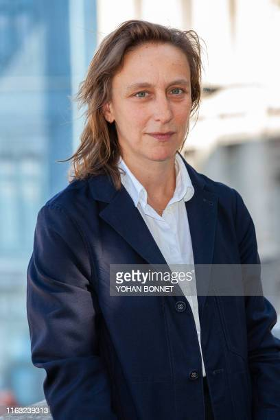 French director Celine Sciamma poses during a photocall of the film Portrait de la jeune fille en feu during the 12th Francophone Angouleme Film...