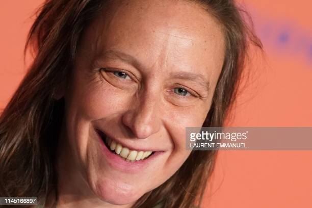 French director Celine Sciamma smiles during a press conference for the film Portrait Of A Lady On Fire at the 72nd edition of the Cannes Film...