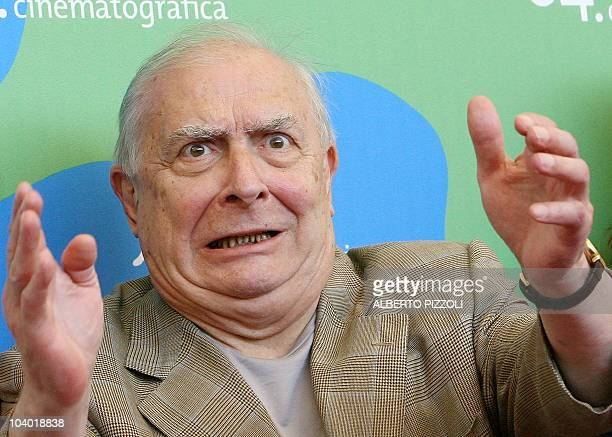 "French director Claude Chabrol gestures as he poses during a photocall for his movie ""La fille coupée en deux"" during the 64th Venice International..."