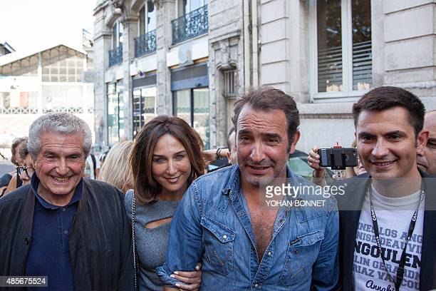 French director Claude Lelouch French actors Elsa Zylberstein and Jean Dujardin and Mayor of Angouleme Xavier Bonnefont attend the inauguration of a...