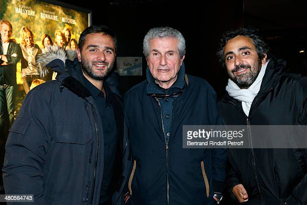 French director Claude Lelouch French directors Olivier Nakache and Eric Toledano both of 'Intouchables' fame pose prior to the private screening of...
