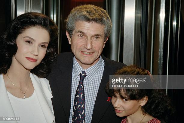 French director Claude Lelouch pose on March 17, 1992 with his wife actress Alessandra Martines and his daughter Salomé for the premiere of the film...