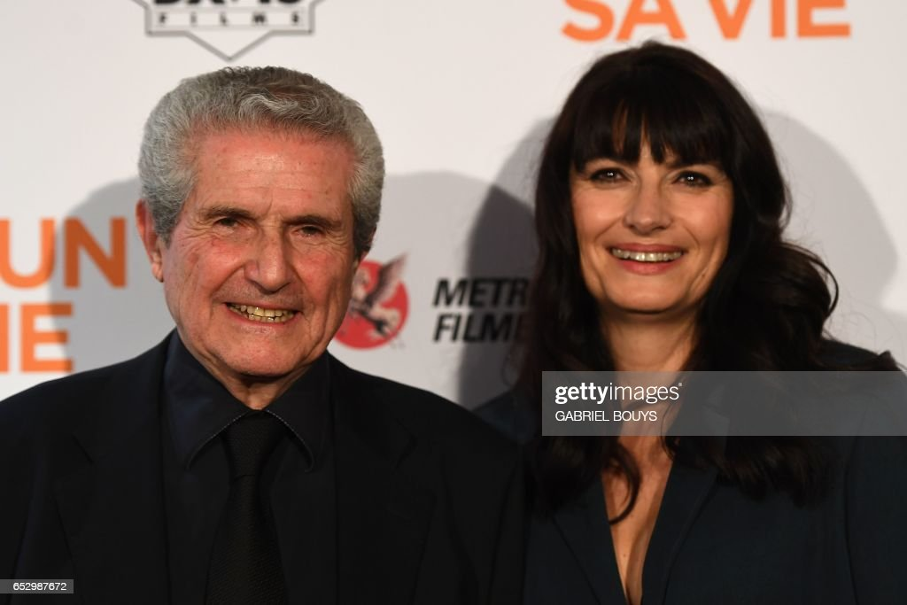 French director Claude Lelouch poses with his wife photographer Valerie Perrin during the photocall for the premiere of his film 'Chacun Sa Vie' in Paris on March 13, 2017