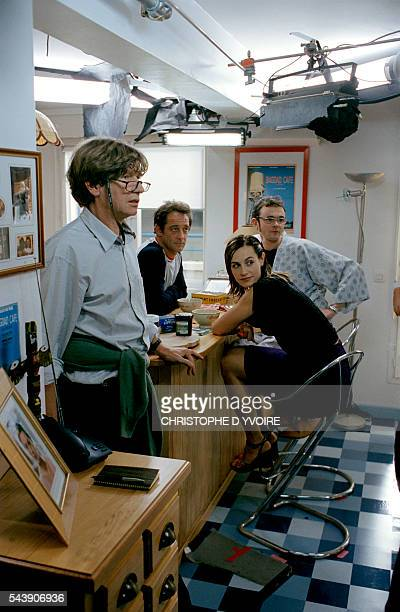 French director Etienne Chatiliez on the set of his film La Confiance Regne with French actors Cecile de France Vincent Lindon and Eric Berger