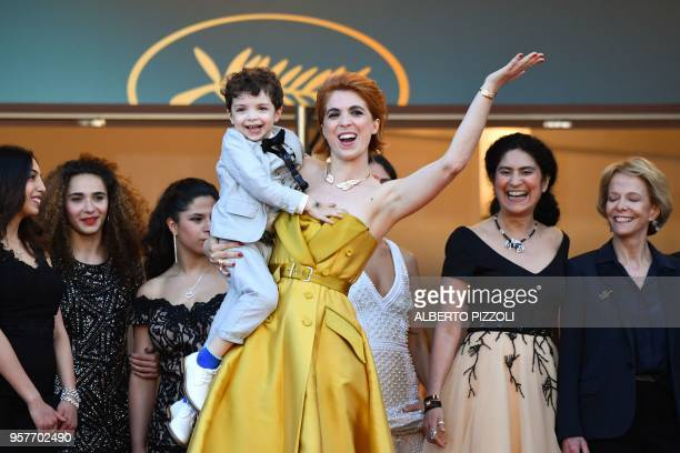 French director Eva Husson poses with her son on May 12 2018 for the screening of the film 'Girls of the Sun ' at the 71st edition of the Cannes Film...