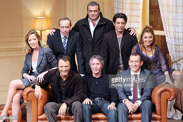 French director Francis Veber poses with French actors Arthur , Dany Boon , Juliette Meyniac, Olivier Granier, Laurent Gamelon, Stephane Bierry and...