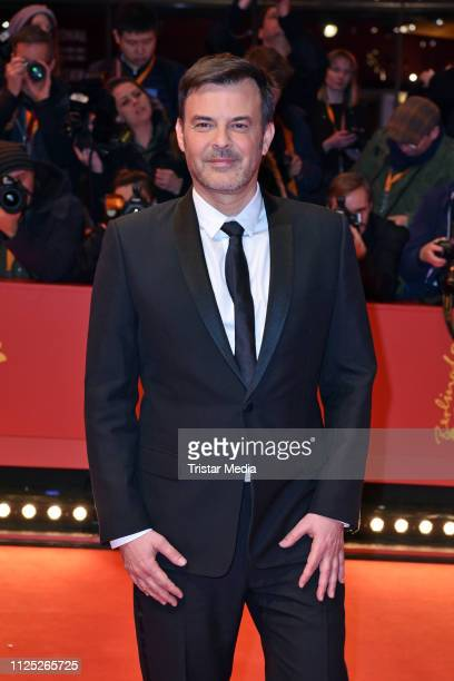 French director Francois Ozon arrives for the closing ceremony of the 69th Berlinale International Film Festival Berlin at Berlinale Palace on...