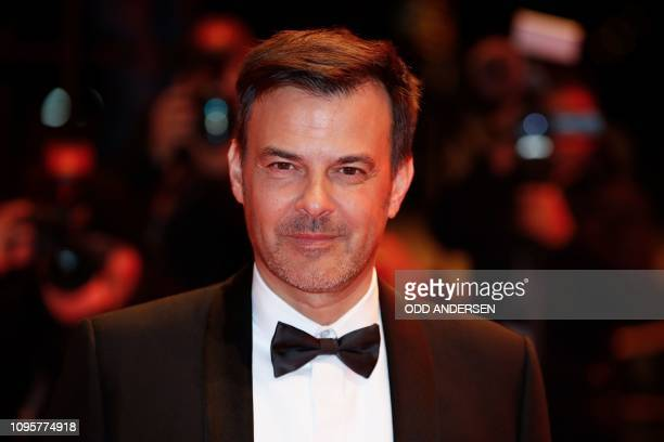 "French director Francois Ozon poses for photographers as he arrives on the red carpet for the premiere of the film ""Grace a Dieu"" during the 69th..."