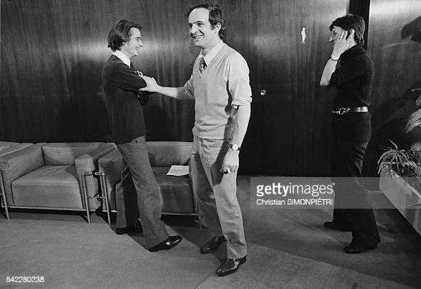 French director Francois Truffaut with his assistant Suzanne Chifman and actor JeanPierre Leaud on the set of the 1970 film Domicile conjugal