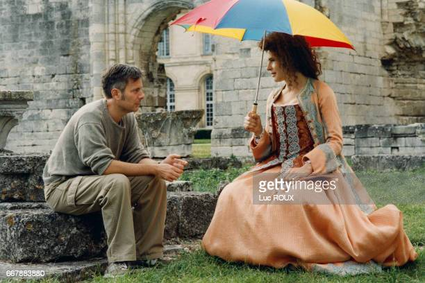 French director Gabriel Aghion and actress Fanny Ardant on the set of Aghion's film Le Libertin