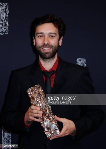 """French director Gabriel Harel poses with his trophy during a photocall after he won the Best Animated Short Film award for """"La Nuit des Sacs..."""