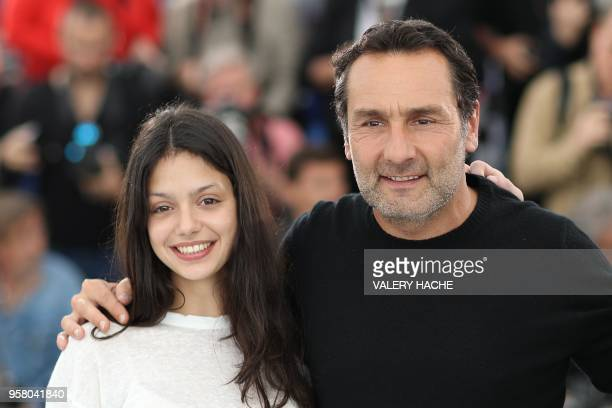 French director Gilles Lellouche and French actress Noee Abita pose on May 13 2018 during a photocall for the film Sink Or Swim at the 71st edition...