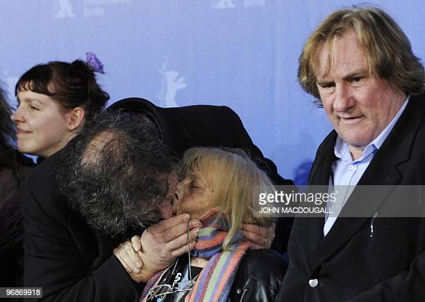 French director Gustave Kervern kisses long time Berlinale photographer Erika Rabau as French actress Miss Ming and French actor Gerard Depardieu...