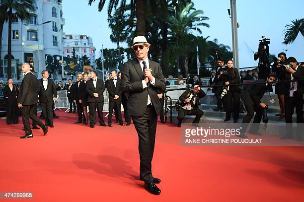 French director Jacques Audiard poses before leaving the Festival palace after the screening of the film 'Dheepan' at the 68th Cannes Film Festival...