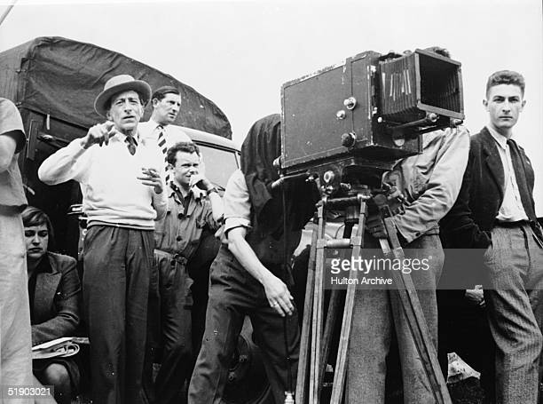 French director Jean Cocteau directs a scene from his film 'La Belle et la Bete' while members of his crew watch France 1946