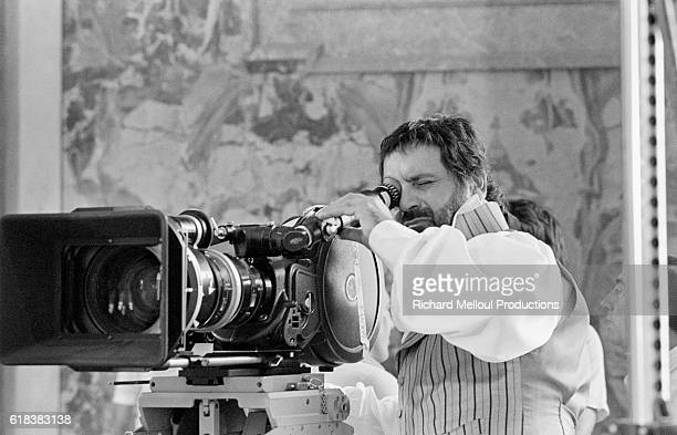 French director Jean Yanne looks through the camera while filming his 1985 movie Liberte Egalite Choucroute Yanne wrote directed and acted in the film