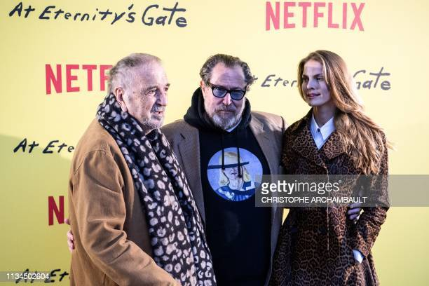 French director JeanClaude Carriere US film director and painter Julian Schnabel and Swedish film editor Louise Kugelberg pose during a photocall...