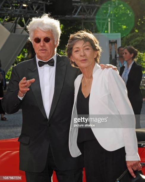 French director JeanJacques Annaud and his wife Laurence arrive to award ceremony of the CineMerit Award at the film festival in Munich Germany 29...