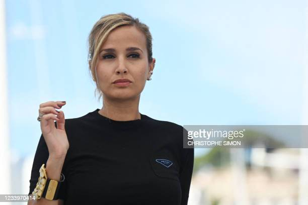 """French director Julia Ducournau poses during a photocall for the film """"Titane"""" at the 74th edition of the Cannes Film Festival in Cannes, southern..."""