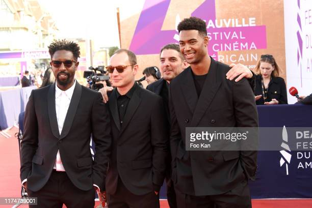 French director Ladj Ly French actor Alexi Manenti Damien Bonnard and French actor Djebril Zonga attend the Award Ceremony during the 45th Deauville...