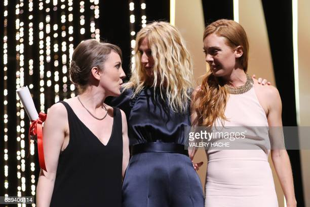 French director Leonor Serraille poses on May 28 2017 with French actress Laetitia Dosch and French actress and President of the Camera d'Or jury...