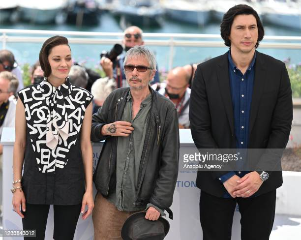 French director Leos Carax and French actress Marion Cotillard and US actor Adam Driver pose during the photocall for tâhe film Annette' in...