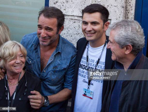 French director MarieFrance Briere French actor Jean Dujardin Mayor of Angouleme Xavier Bonnefont and French director Claude Lelouch attend the...