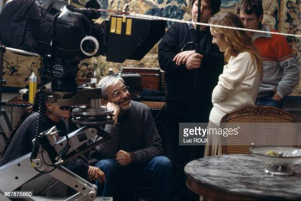 French director Maurice Pialat and actress Sandrine Bonnaire on the set of Pialat's film Sous le Soleil de Satan The film won the Palme d'Or at the...
