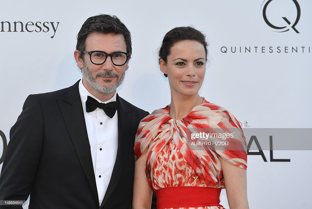 French director Michel Hazanavicius and actress Berenice Bejo pose as they arrive to attend the 2012 amfAR's Cinema Against Aids on May 24, 2012 in Antibes, southeastern France.