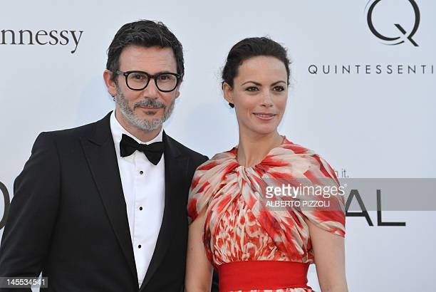 French director Michel Hazanavicius and actress Berenice Bejo pose as they arrive to attend the 2012 amfAR's Cinema Against Aids on May 24, 2012 in...