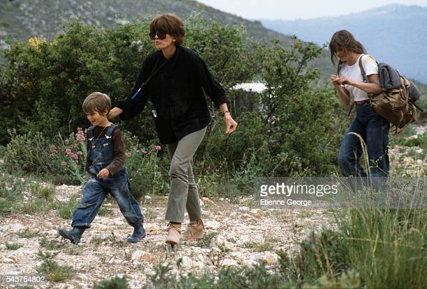 French director Nadine Trintignant on the set of her film Premiere Voyage with her children Vincent and actress Marie The children's father is famous...