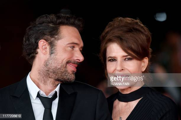 French director Nicolas Bedos and French actress Fanny Ardant pose as they arrive for the screening of Bedos' film La Belle Epoque during the 14th...