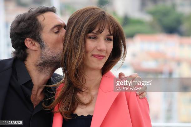 French director Nicolas Bedos kisses French actress Doria Tillier during a photocall for the film La Belle Epoque at the 72nd edition of the Cannes...