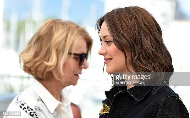TOPSHOT French director Nicole Garcia and French actress Marion Cotillard pose on May 15 2016 during a photocall for the film Mal de Pierres at the...