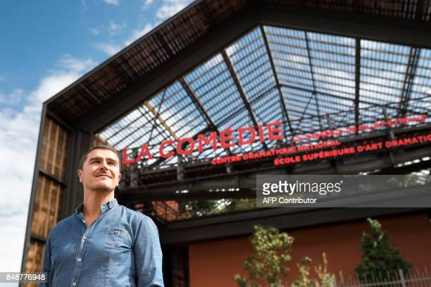 French Director of Comedie de Saint-Etienne National Dramatic Art Center Arnaud Meunier poses in front of the new premises on September 14 in...