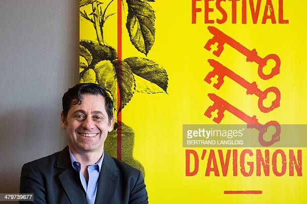 French director of the Avignon theatre Festival Olivier Py poses in front of the 68th Avignon Festival poster during a press conference in Avignon...