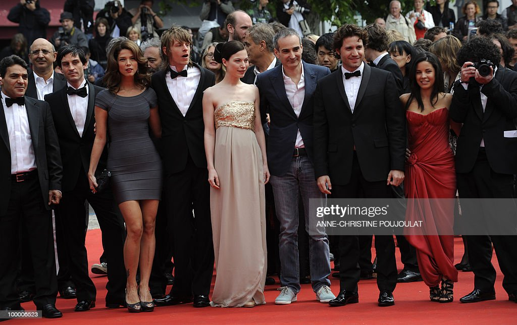 French director Olivier Assayas (4thR) and Venezuelian born actor Edgar Ramirez (3rdR), Colombian actress Juana Acosta (3rdl) arrive with the cast for the screening of 'Carlos' presented out of competition at the 63rd Cannes Film Festival on May 19, 2010 in Cannes.