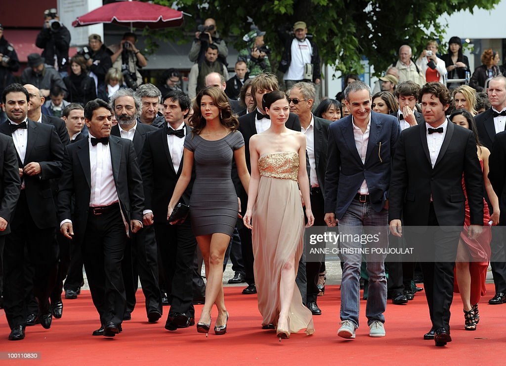 French director Olivier Assayas (2ndR), Austrian actress Nora von Waldstätten (3rdR) and Venezuelian born actor Edgar Ramirez (R) arrive with the cast for the screening of 'Carlos' presented out of competition at the 63rd Cannes Film Festival on May 19, 2010 in Cannes.