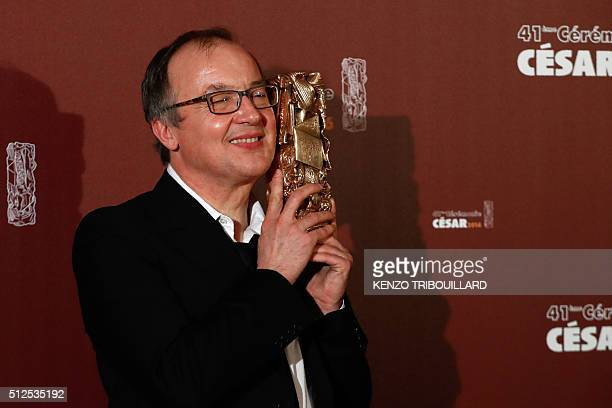 French director Philippe Faucon poses with his trophy during a photocall after he won the Best Feature Film award for 'Fatima' during the 41st...