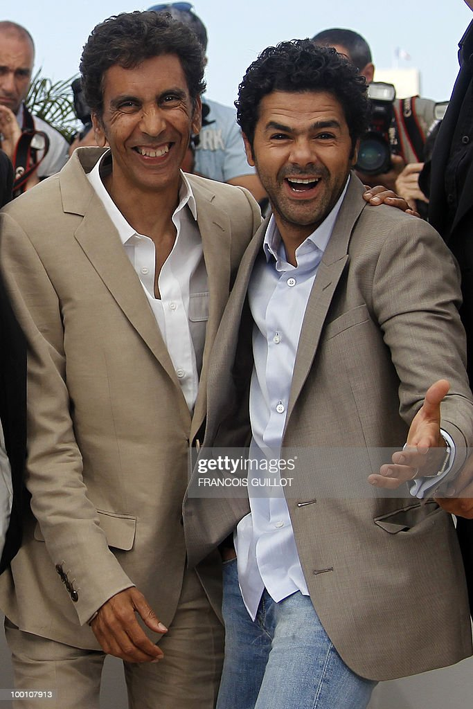 French director Rachid Bouchareb and French actor Jamel Debbouze pose during the photocall of 'Hors La Loi' (Outside of the Law) presented in competition at the 63rd Cannes Film Festival on May 21, 2010 in Cannes.