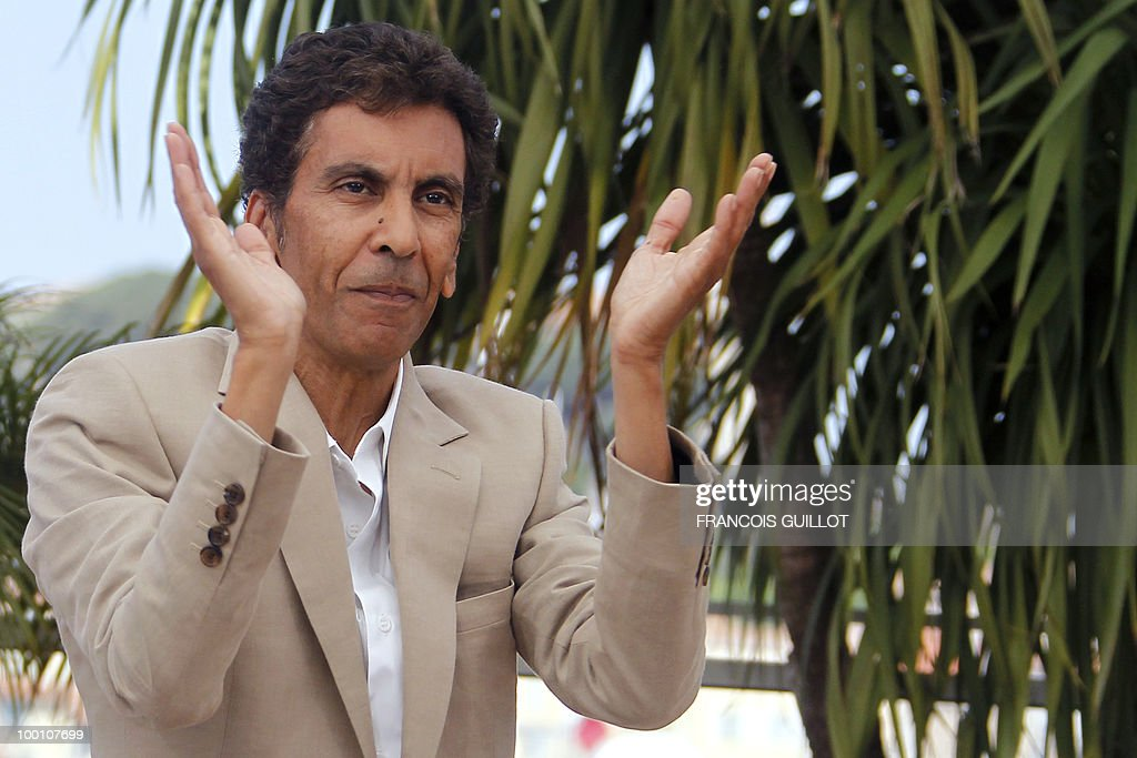 French director Rachid Bouchareb poses during the photocall of 'Hors La Loi' (Outside of the Law) presented in competition at the 63rd Cannes Film Festival on May 21, 2010 in Cannes.