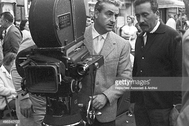 French director Renà© Clà©ment standing behind the camera and talking to an assistant on the set of the film 'Purple Noon' Rome
