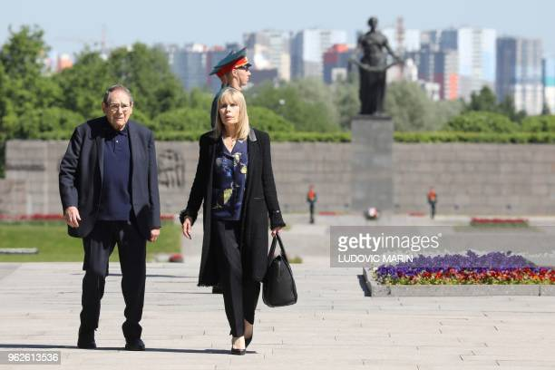 French director Robert Hossein and his wife Candice Patou take part in a ceremony at the Piskaryovskoye Memorial Cemetery, where the victims of the...